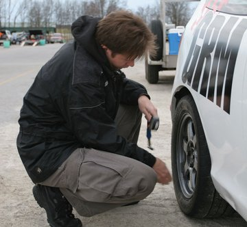 Racing isn't all glamour and glory, as sometimes you have to check your tire pressures and unload the car.