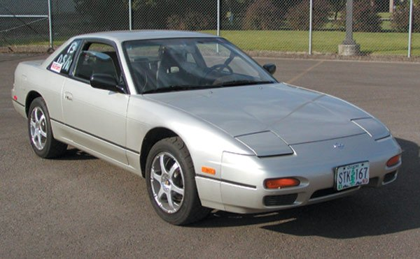 "The earlier S13-chassis 240SX is more wedge-shaped on the outside, yet the car's interior is softer and more ""organic"" than its successor."